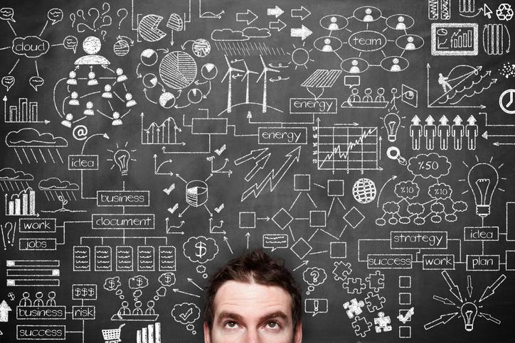 Businessman Idea Concept on blackboard.