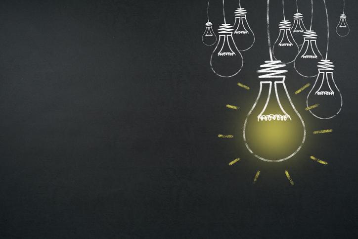 Creative bulb drawn on a chalkboard rocking agitation Draw out an idea