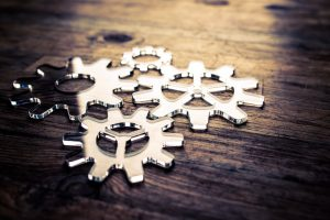 4 gears on a wooden desk
